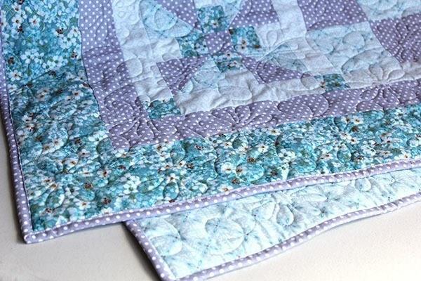 snuggle blossom crib quilt